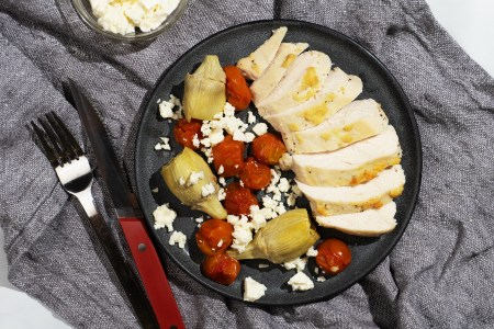 Garlic Roasted Chicken with Artichokes, Tomatoes, and Feta
