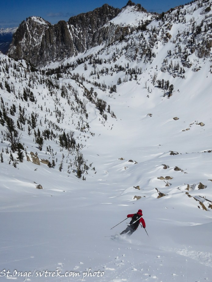 Skiing the final slopes below the Monolith