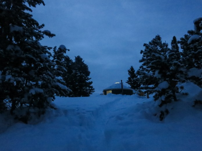 pre-dawn view of the Coyote Yurts, coffee is ready and powder is waiting.