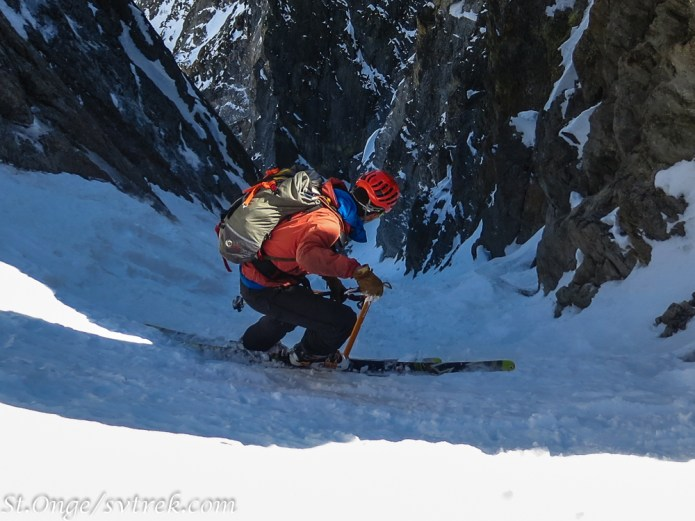 Using an ice axe for security on the firm entrance