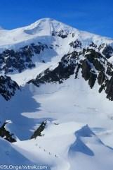 Endless mountains dwarf the skiers