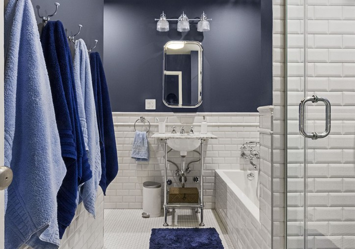 Penny Tile Takes This Bath From Beige To Blue Beauty