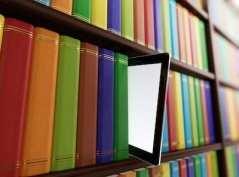 ebook tablet on bookshelf