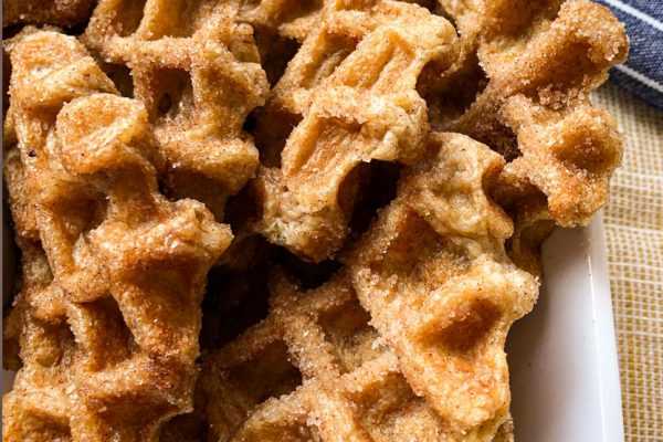 waffle churros in a white dish