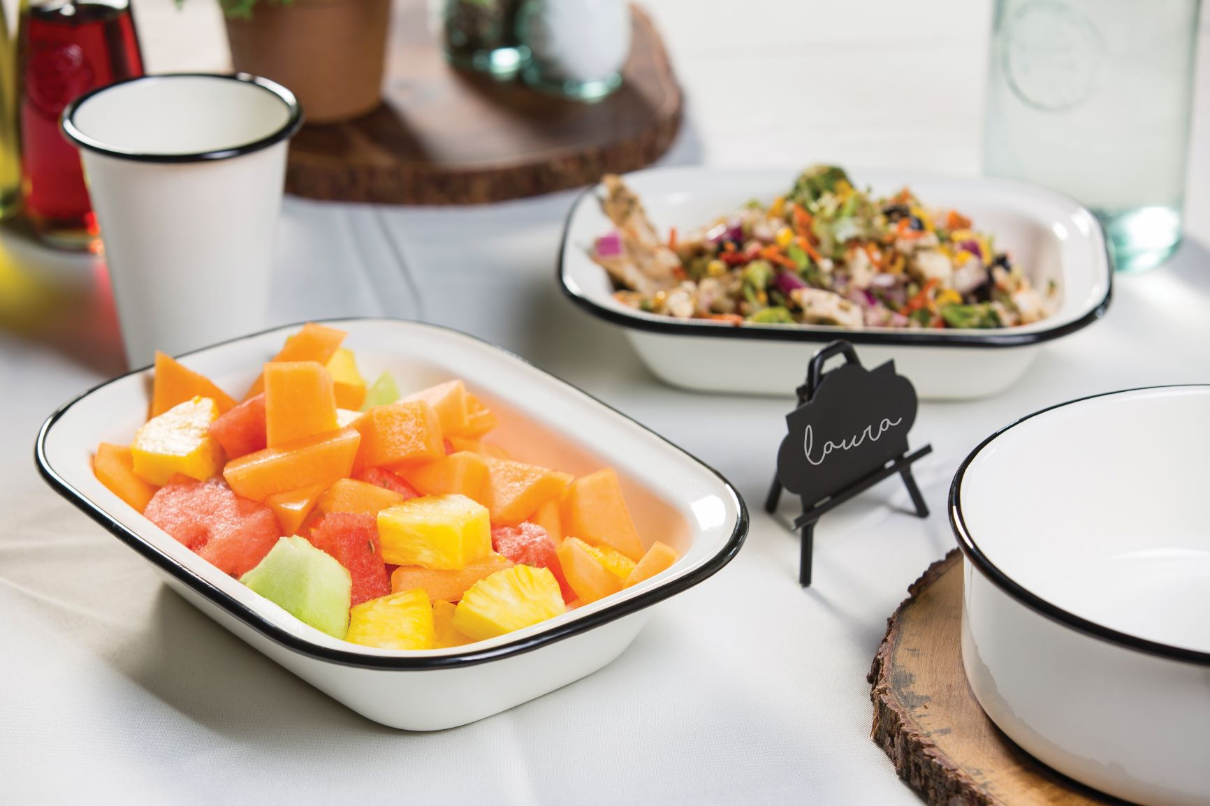 enamelware dish with fruit on a table