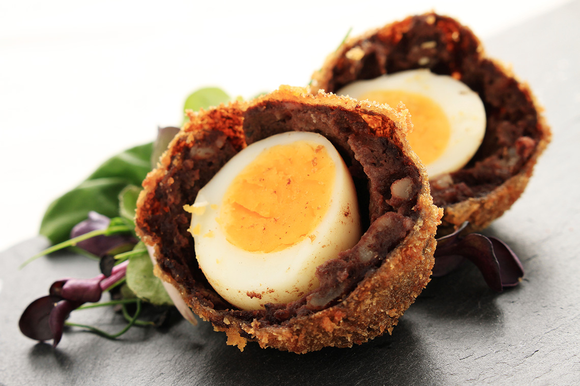 scotch manchester egg quail egg covered in black pudding and breadcrumbs