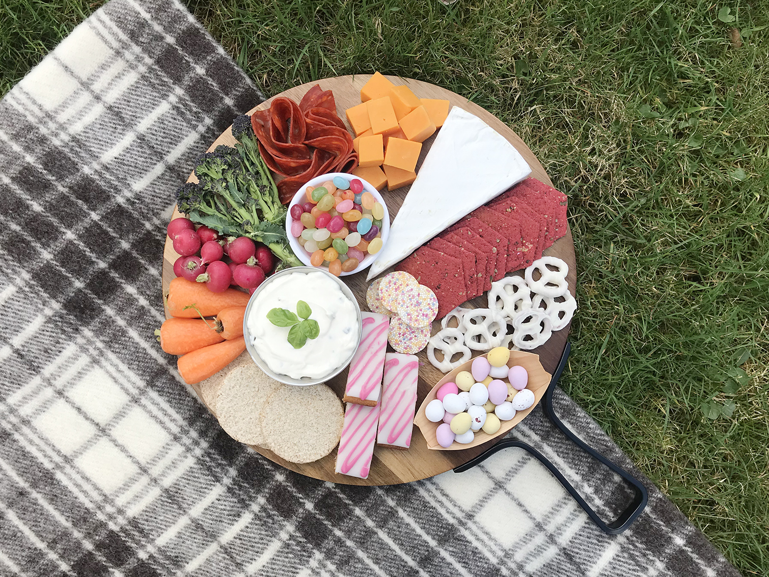 sweet and savoury snack board in bright colors