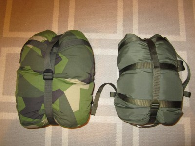 Swedish Armed Forces summer sleepingbag compressed in the green and Fjällräven compressed in M90 sack.
