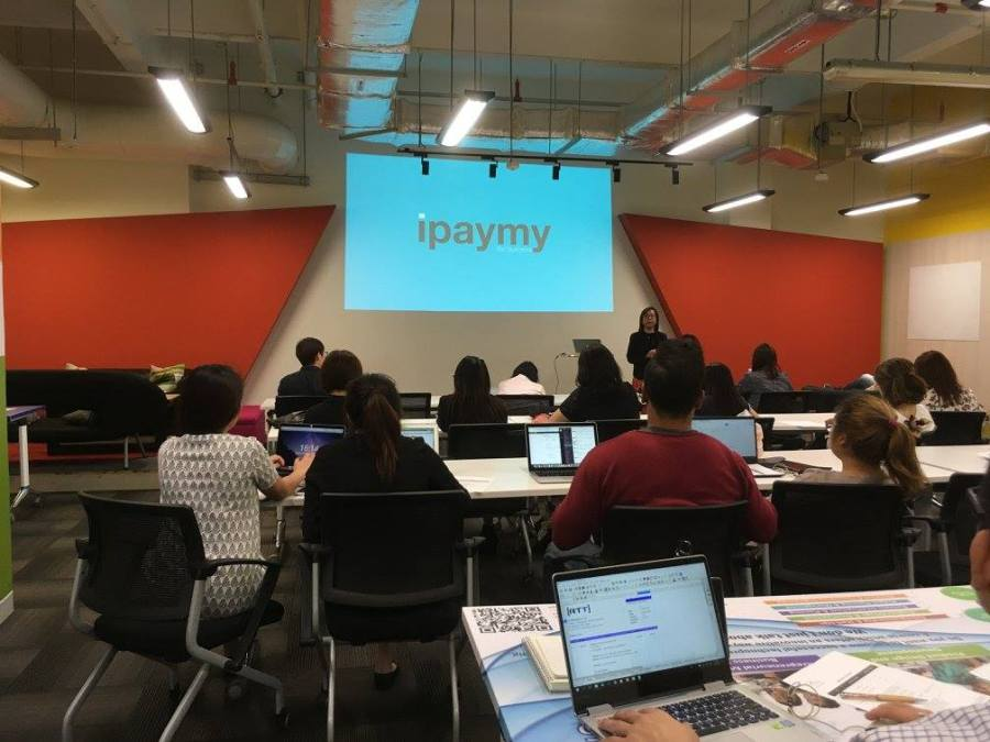Chrystie Dao-Szabo, founder of iPayMy making a presentation