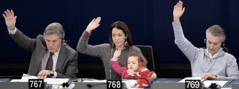 female politician with her young daughter at the European Parliament voting session