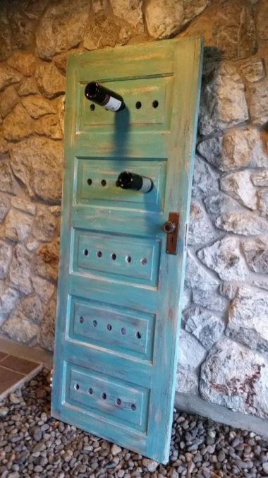 old-door-becomes-a-new-wine-rack-repurpose-doors-repurposing-upcycling