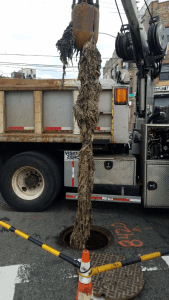 Wipes can clog sewer systems, forcing crews to implement costly repairs like this one.