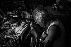 Photo of a watchmaker using their tools