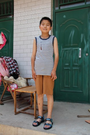 Boy in donated Tea clothes.