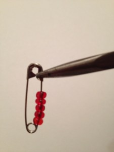 Needle nose pliers and your beaded safety pin.