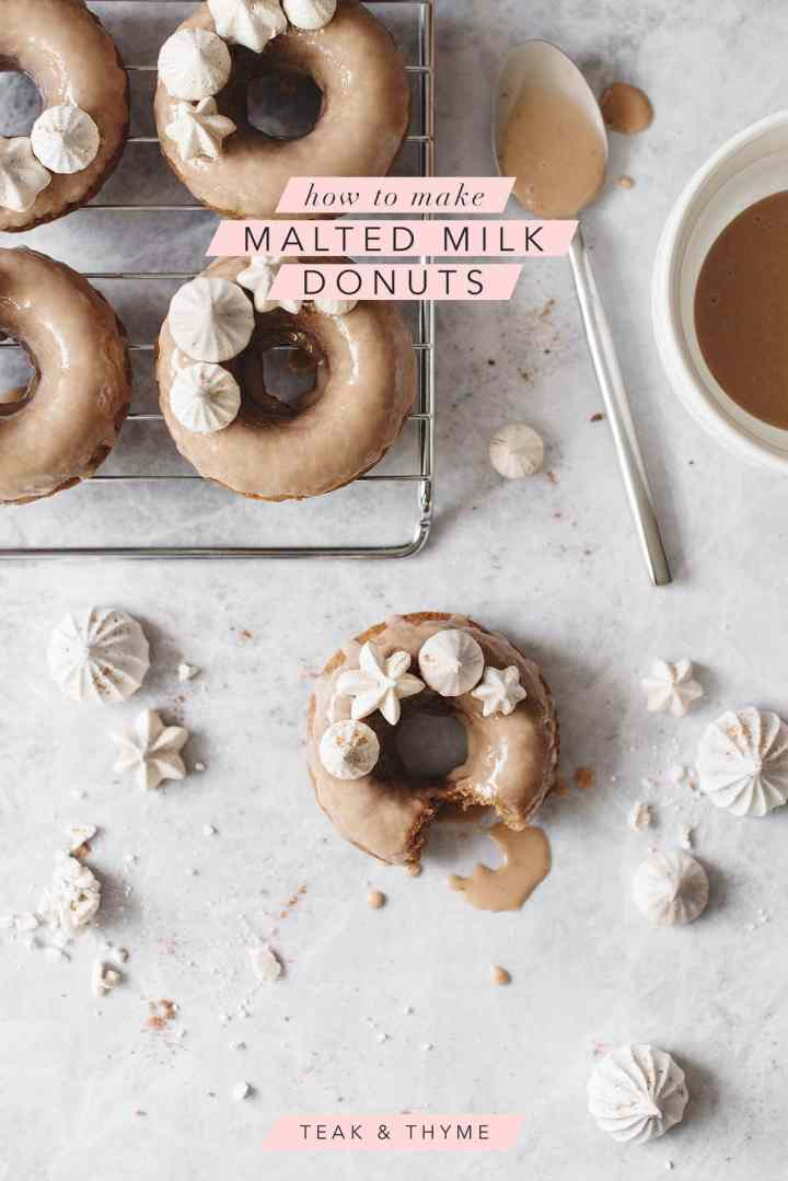 Malted milk donuts topped with meringue kisses on a metal cooling rack