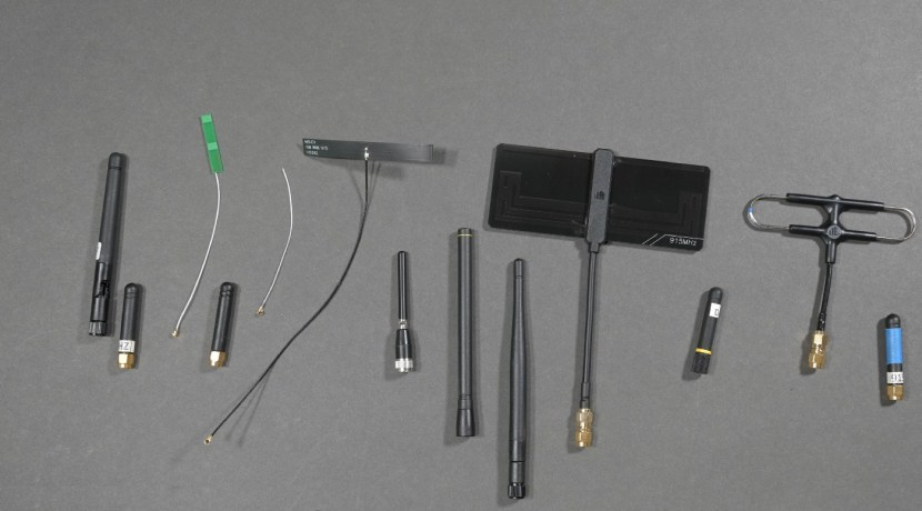 A selection of different antennas on a gray counter.