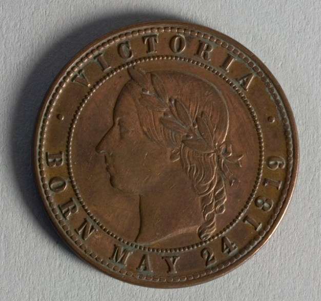 Reverse of token issued by Auckland Licensed Victuallers Association, 1871. Made by Joseph Moore of Birmingham. Te Papa (NU002349)