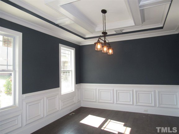 formal dining room with wainscoting