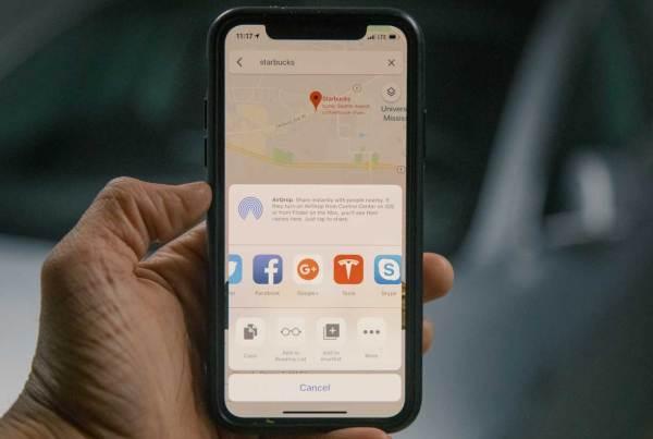 Close up shot of an iPhone with Tesla app