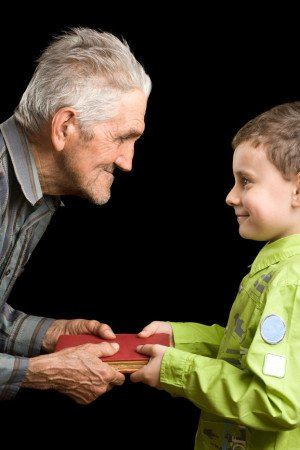 Grandfather and grandson with book