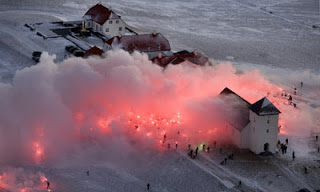 Photo Source: Reuters (2008) Icelanders marched with torches over bank bailouts.