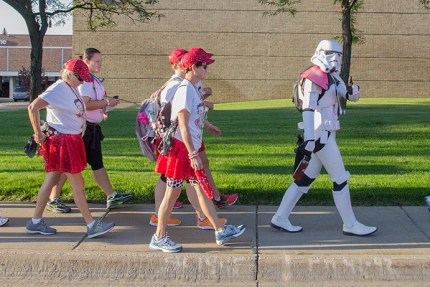 Kevin as a stormtrooper moves out onto the route after the Opening Ceremony on the Twin Cities 3-Day, to the delight of children and adults on the route breast cancer