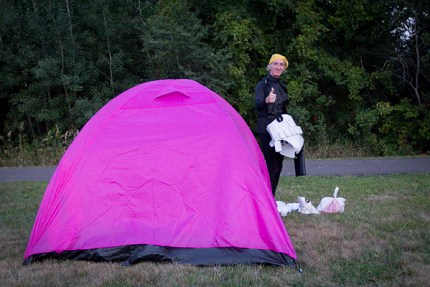 Kevin D emerges from his pink tent to walk Day 3 of the Twin Cities 3-Day in honor of his wife