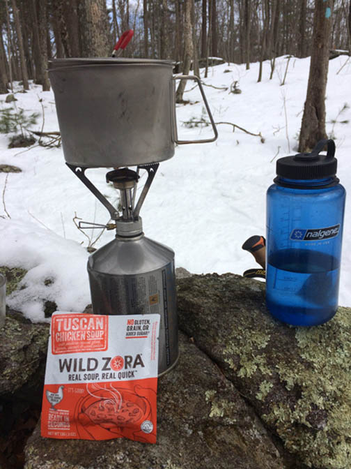 backpack camp stove and nalgene water bottle demonstrating the importance to heat and water for backcountry emergencies