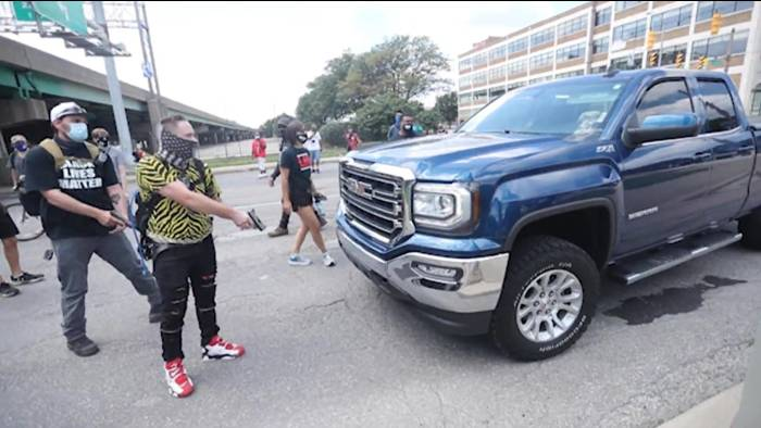 armed protesters holding a truck at gunpoint showing the need for Defensive Motor Vehicle Tactics