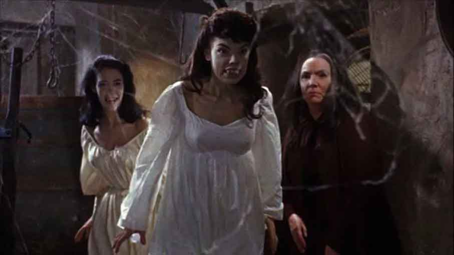 Scene from Brides of Dracula showing a woman with fake teeth.