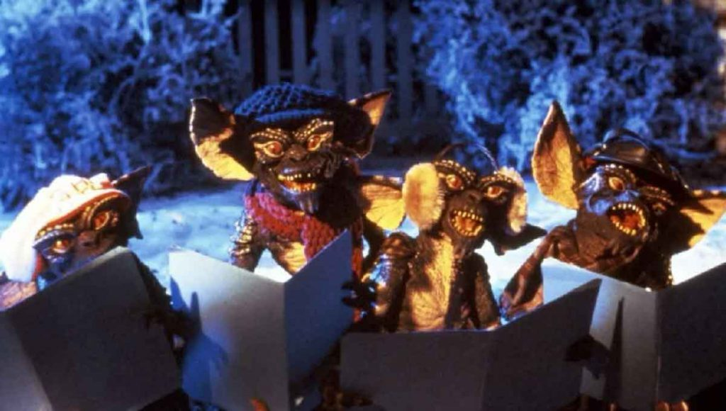 The gremlins themselves singing Christmas carols from the movie Gremlins released in 1984.