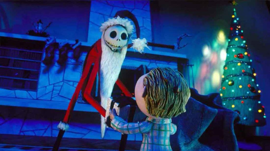 Jack Skellington handing a boy a present in the movie The Nightmare Before Christmas.