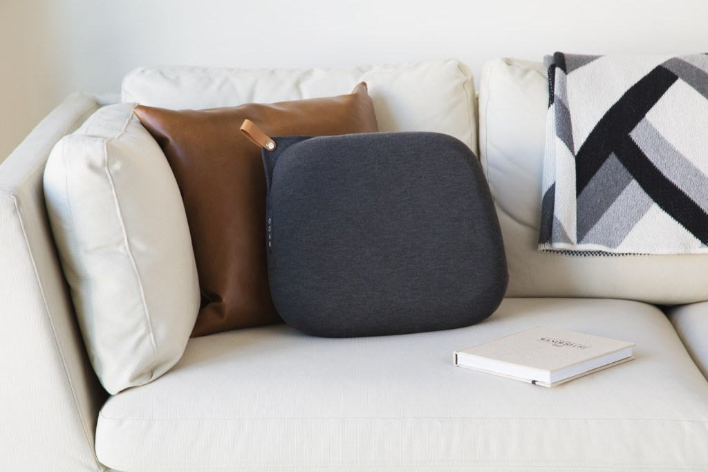 Expain's heated back massager sits on a couch, perfectly integrating into the decor