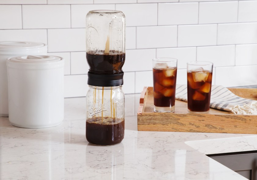 Fresh cold brew is seen being strained in mason jars thanks to BRUW's cold brew mason jar starter pack