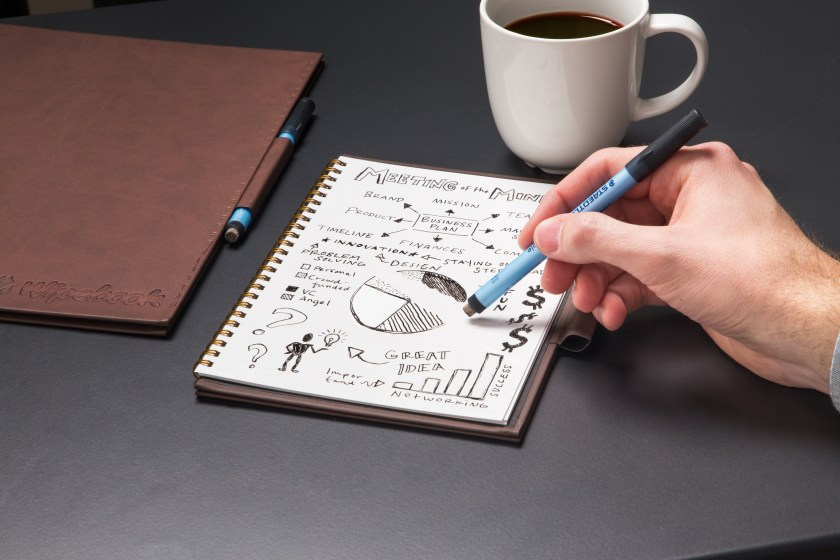 A pwerson draws & erases on Wipebook Pro's whiteboard notebook
