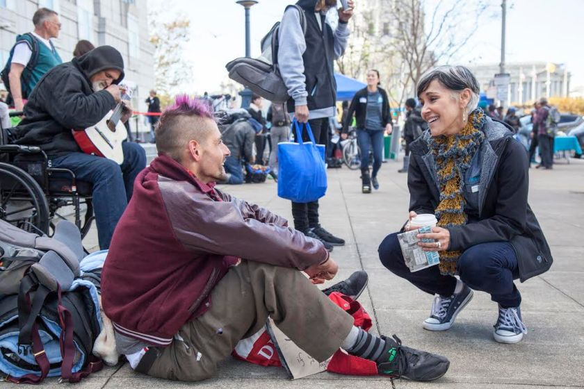 Lava Mae founder Doniece Sandoval chats with homeless man on the street