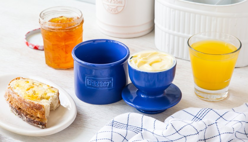 A blue Butter Bell sits on a breakfast counter next to toast & OJ