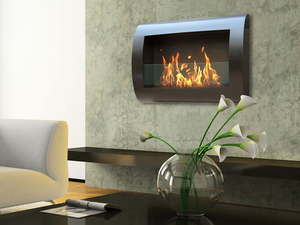 A roaring fire bellows from this wall-mounted ventless fireplace by Anywhere Fireplace