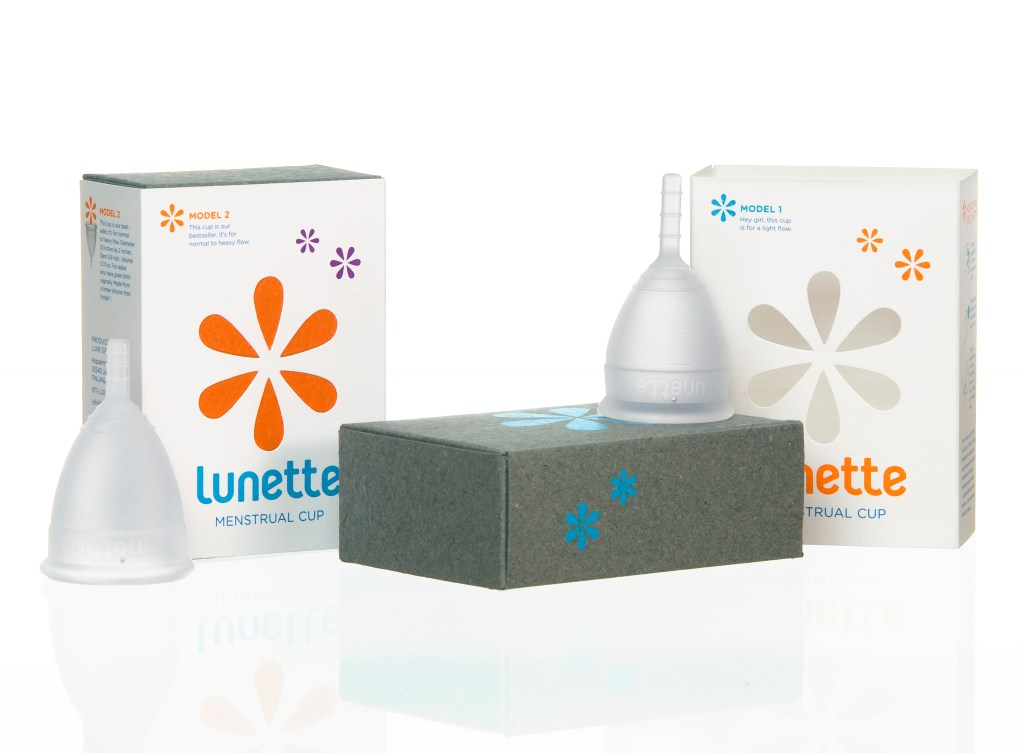 Boxes of Lunette's reusable silicone menstrual cups are displayed