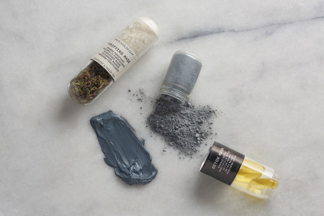 Capsules of Oleum Vera's DIY face mask kits sit on a counter