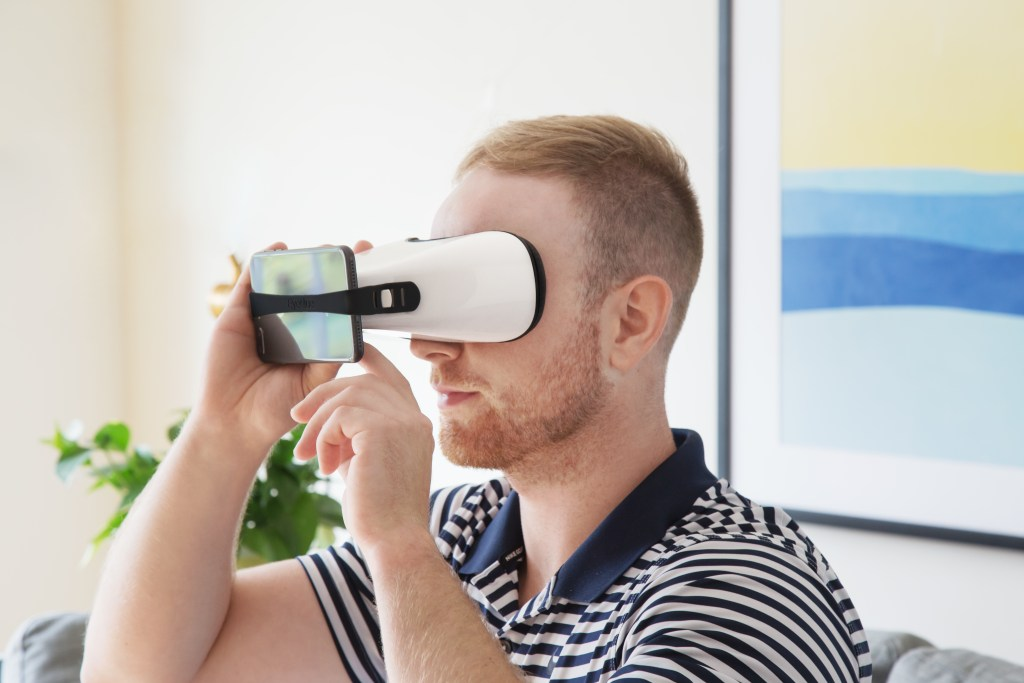 A man is seen using EyeQue's Insight device to test his visual acuity