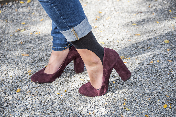 A woman is seen wearing burgundy pumps with a pair of Keysocks knee-high no-show socks under her jeans