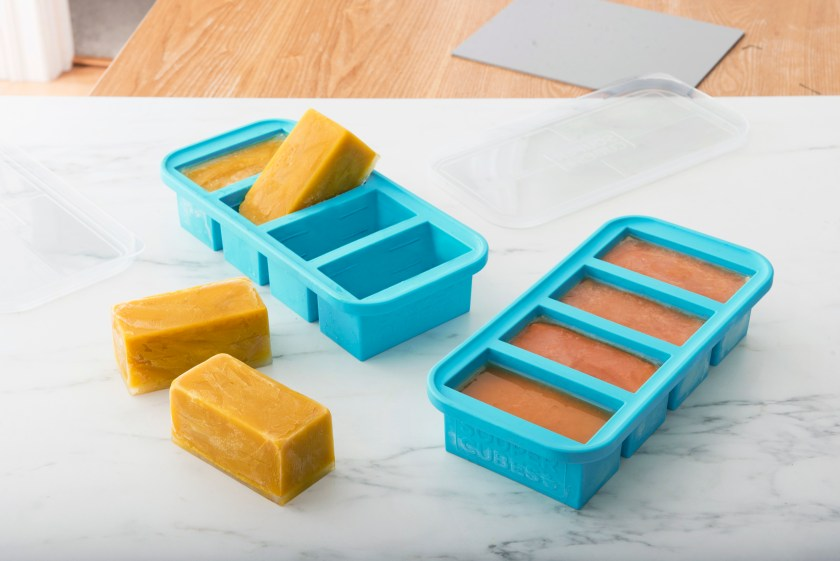 Cubes of chicken stock are seen frozen in Souper Cubes silicone freezer trays