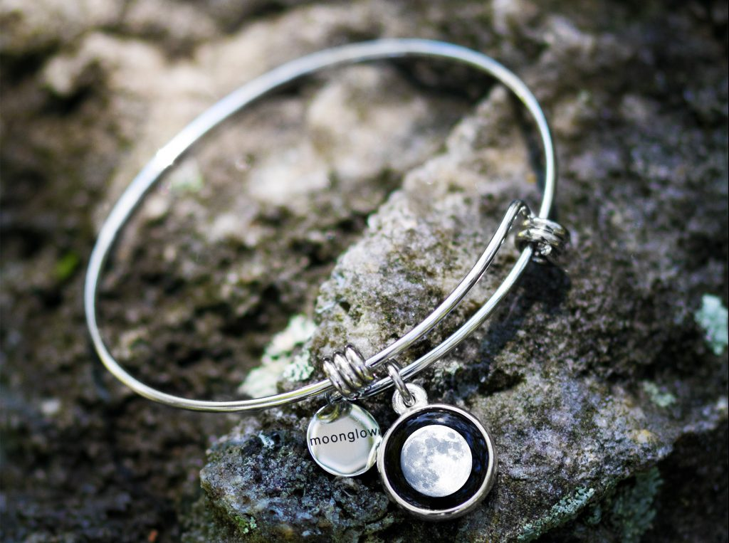 A full moon is seen depicted on a Moonglow sterling silver bangle