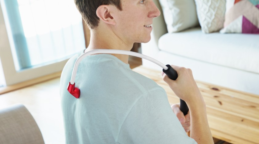 A man is seen massaging his own back with Back Nodger's self-back massager