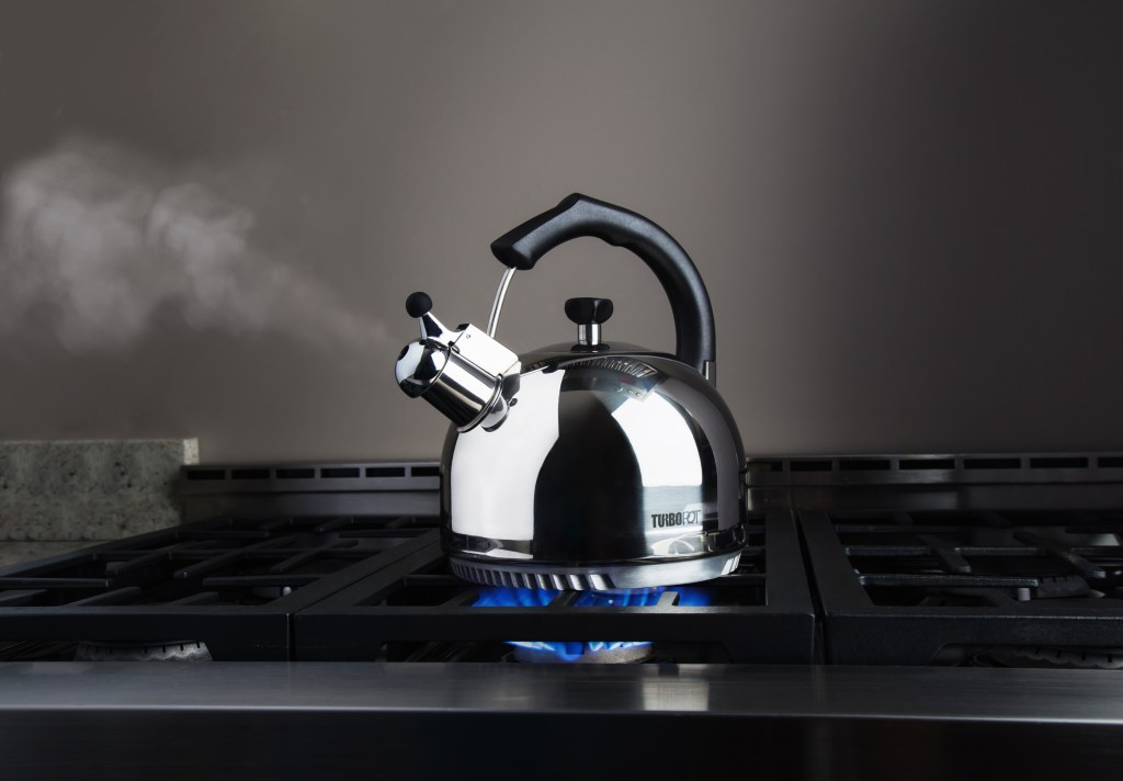 A rapid boil tea kettle from Turbo Pot is seen steaming on a stove top