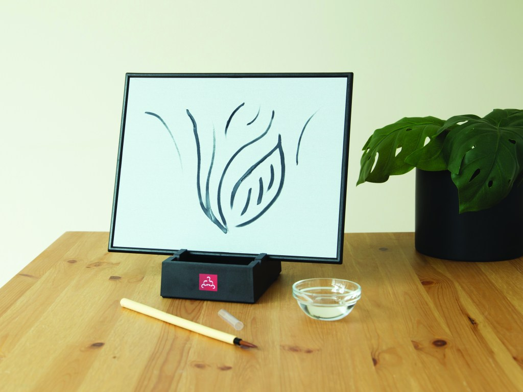 A watercolor drawing is seen on a Buddha Board