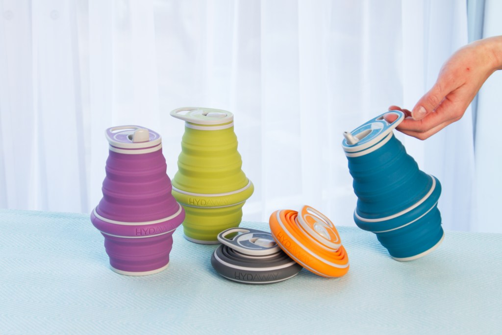 5 colored collapsible water bottles from Hydaway rest on a table