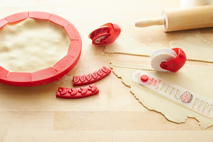 A silicone pie shield, decorators and crust cutter from Talisman designs seen used to create a pie